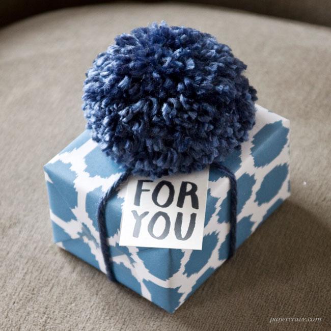 Oversized Pom Pom Gift Wrap Idea